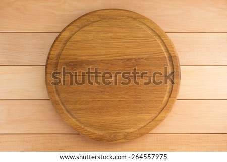 cutting board on wooden background - stock photo