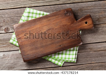 Cutting Board Over Towel On Wooden Stock Photo 437178214