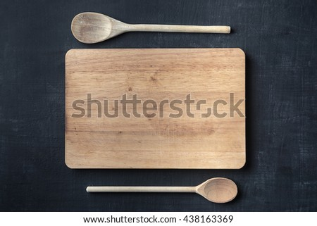 Cutting board with spoon background - stock photo