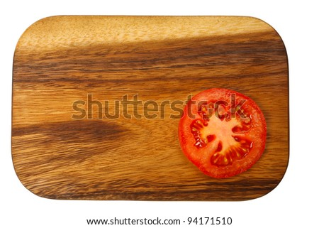 Cutting board with tomato slices isolated on white
