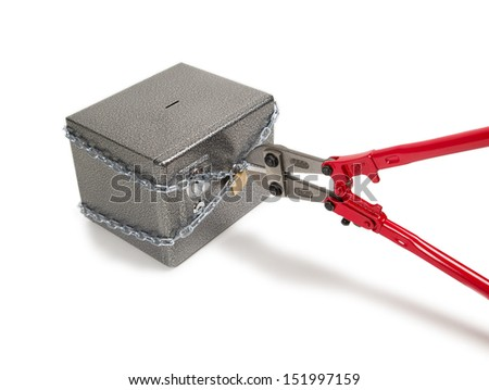 Cutting chain on safe with bolt cutters. Robbery concept. - stock photo