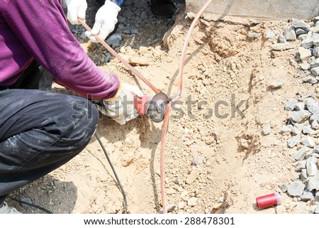 Cutting copper ground wire - stock photo