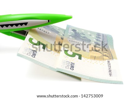 cutting costs concept with money, scissors - stock photo