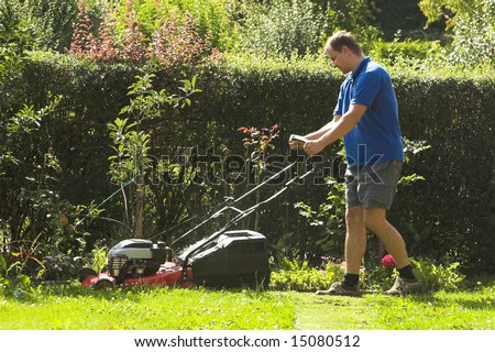 cutting grass - stock photo