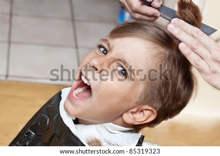cutting hair at the barber - stock photo