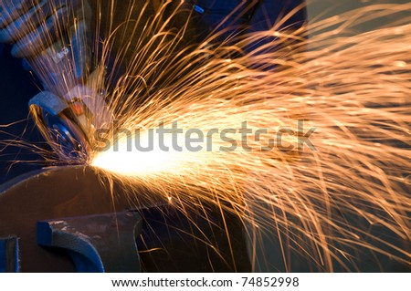 Cutting metal causing sparks isolated - a series of METAL INDUSTRY images. - stock photo