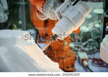 Cutting of Styrofoam , workers hands angle grinder tool