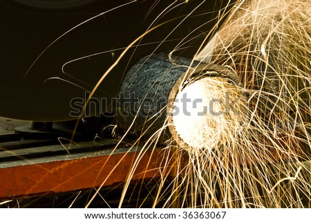 cutting pipe - stock photo