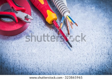 Cutting pliers insulated screwdriver corrugated pipe wire protection insulation tape. - stock photo