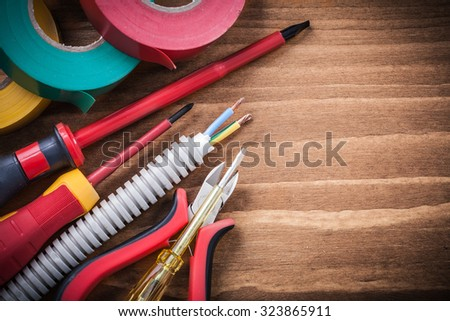 Cutting pliers insulated screwdriver corrugated tube electrical wires insulating tape. - stock photo