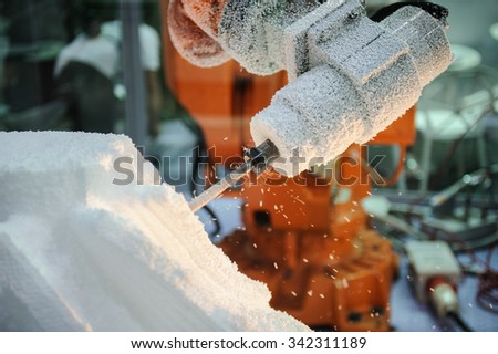 Cutting Polystyrene foam machine in  factory, workers hands angle grinder tool