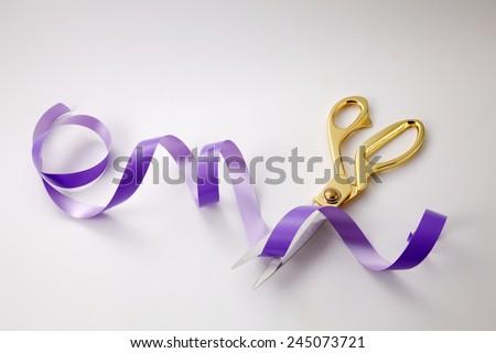 cutting purple ribbon -open ceremony concept - stock photo