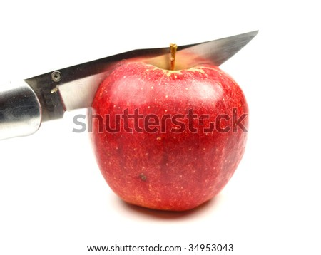 Cutting red apple