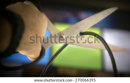 Cutting the cable on TV - concept image - stock photo