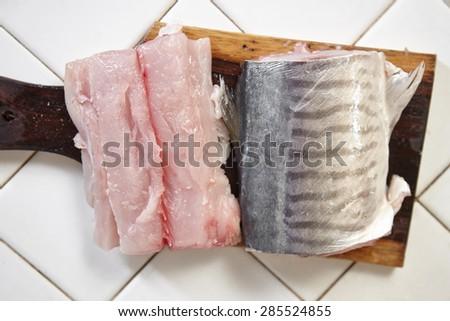Cutting the fish to make fish ball - stock photo