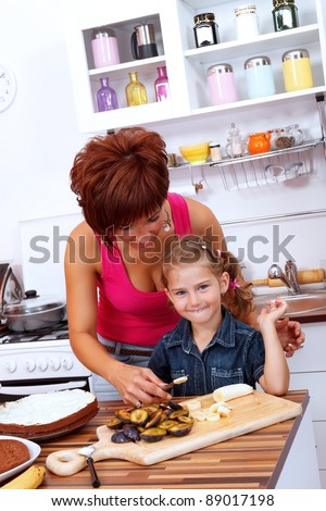 Cutting the fruits for the cake - stock photo