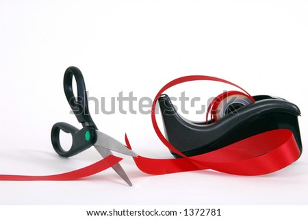 Cutting the red tape - stock photo
