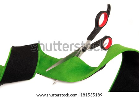 cutting the ribbon green isolated on white - stock photo