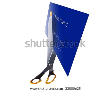 Cutting up credit card with scissors on white - stock photo