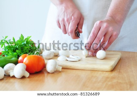 Cutting vegetables - stock photo