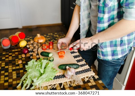 Cutting vegetables for a salad on the board, ingredients, close - stock photo