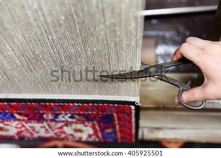 cutting warps of carpet - stock photo