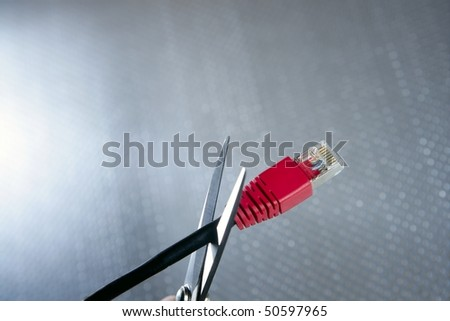 Cutting with wired technology metaphor, ethernet RJ45 cable scissors - stock photo
