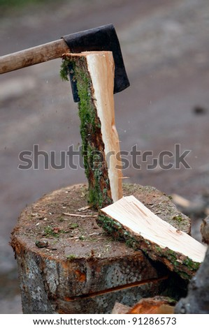 Cutting wood with an ax - stock photo