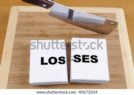Cutting Your Losses with a Cleaver and Cutting Board. - stock photo
