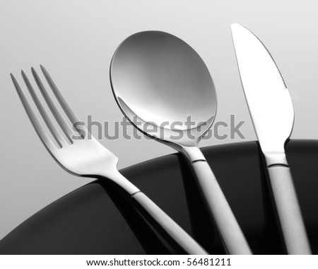 Cuttlery set of steel fork, knife and spoon - stock photo