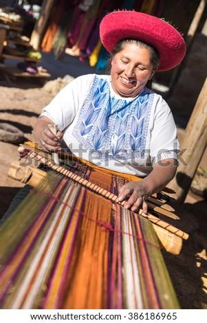 CUZCO, PERU - CIRCA 2015: An unidentified woman work in a loom circa 2015 in Cuzco, per - stock photo