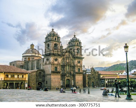 CUZCO, PERU - JAN 16, 2015: Plaza de armas in sunset with local people. It is a centre point of Cusco city, Cusco, Peru. - stock photo