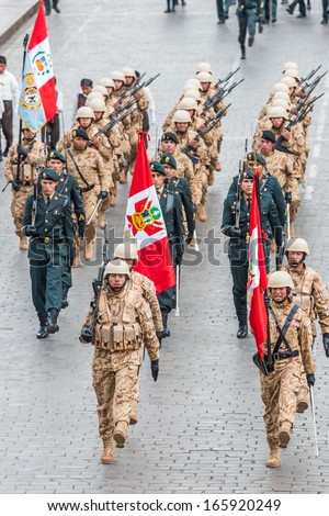 CUZCO, PERU - JULY 14: army parade in the Plaza de Armas in Cuzco Peru on july 14th, 2013. This plaza has been the scene of the proclamation by Francisco Pizarro in the conquest of Cuzco - stock photo