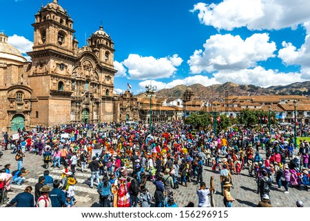 Cuzco, Peru - July 12, 2013: people at festival  in the Plaza de Armas at Cuzco Peru on july 12th, 2013. This plaza has been the scene of the proclamation by Francisco Pizarro in the conquest of Cuzco - stock photo