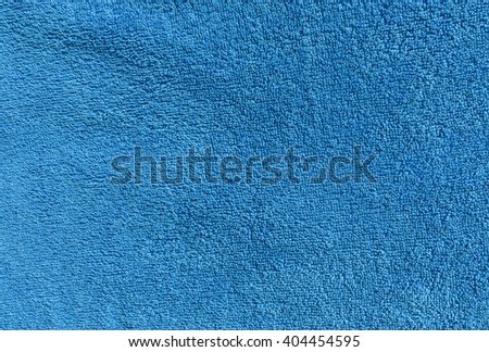 Cyan bath towel texture. Background and texture for design. - stock photo
