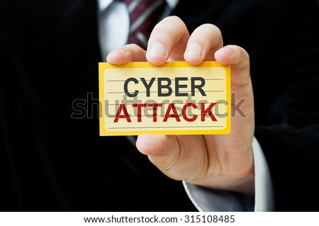 Cyber Attack card in hand - stock photo