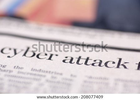 Cyber attack written newspaper. Cyber attack written newspaper, shallow dof, real newspaper.  - stock photo