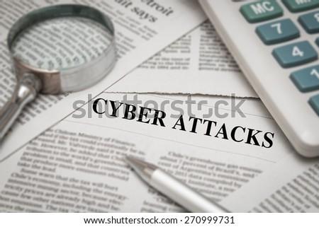 cyber attacks headline on newspaper - stock photo