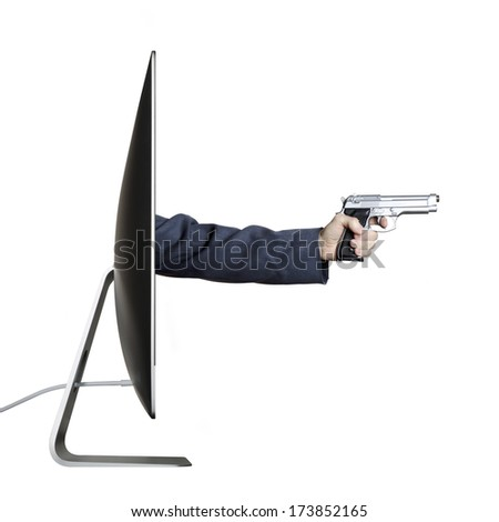 Cyber crime. Hand holding a gun, extending out from a computer screen.  - stock photo