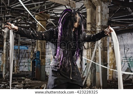 Cyber gothic girl in an abandoned factory. Film grain effect - stock photo