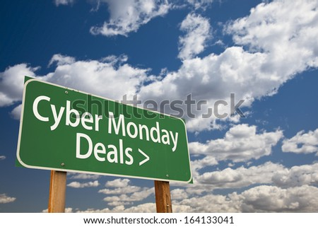 Cyber Monday Deals Green Road Sign with Dramatic Clouds and Sky.