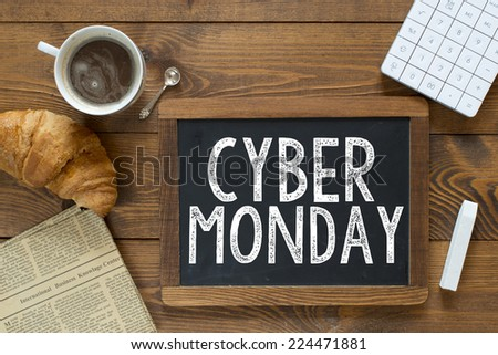 Cyber monday handwritten with white chalk on a blackboard on a wooden background - stock photo