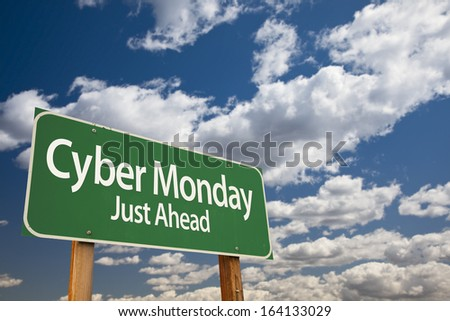 Cyber Monday Just Ahead Green Road Sign with Dramatic Clouds and Sky. - stock photo