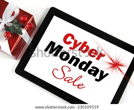 Cyber Monday Sale shopping message on black computer tablet device on white background with Christmas gift. - stock photo