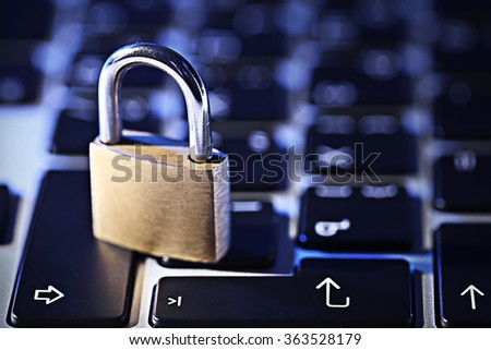 Cyber safety concept - lock on computer keyboard - stock photo