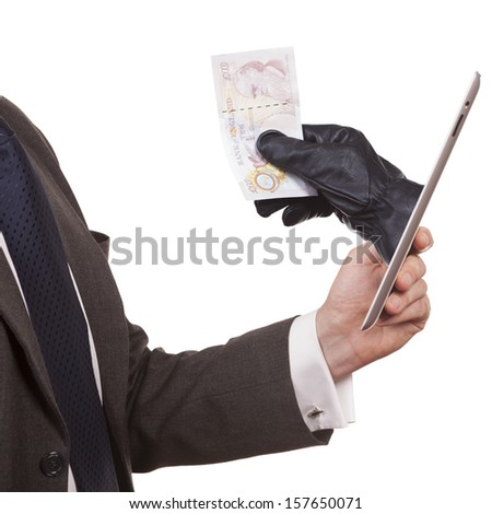 Cyber theft being committed through a tablet computer. A man wearing a suit is holding a tablet computer while a hand is reaching through screen to steal money. white background.  - stock photo