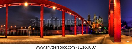 Cybinski bridge and the Cathedral in Poznan in the evening - stock photo