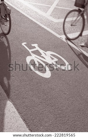 Cycle Lane with Cyclist in Dublin, Ireland in Black and White Sepia Tone
