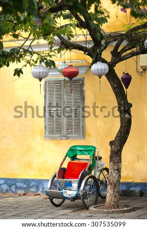 Cycle Rickshaw in the ancient town of Hoi An, Vietnam - stock photo