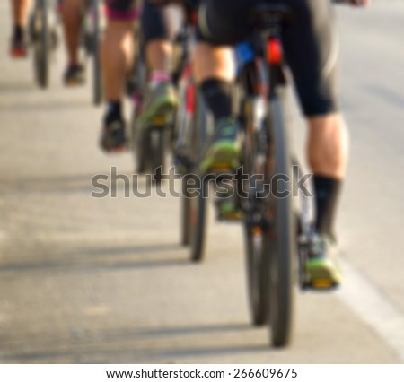 Cycling, image is out focus and motion blur